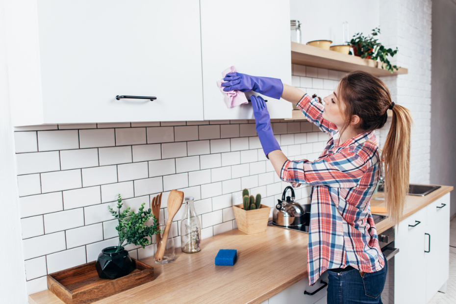 Young woman cleaning her house