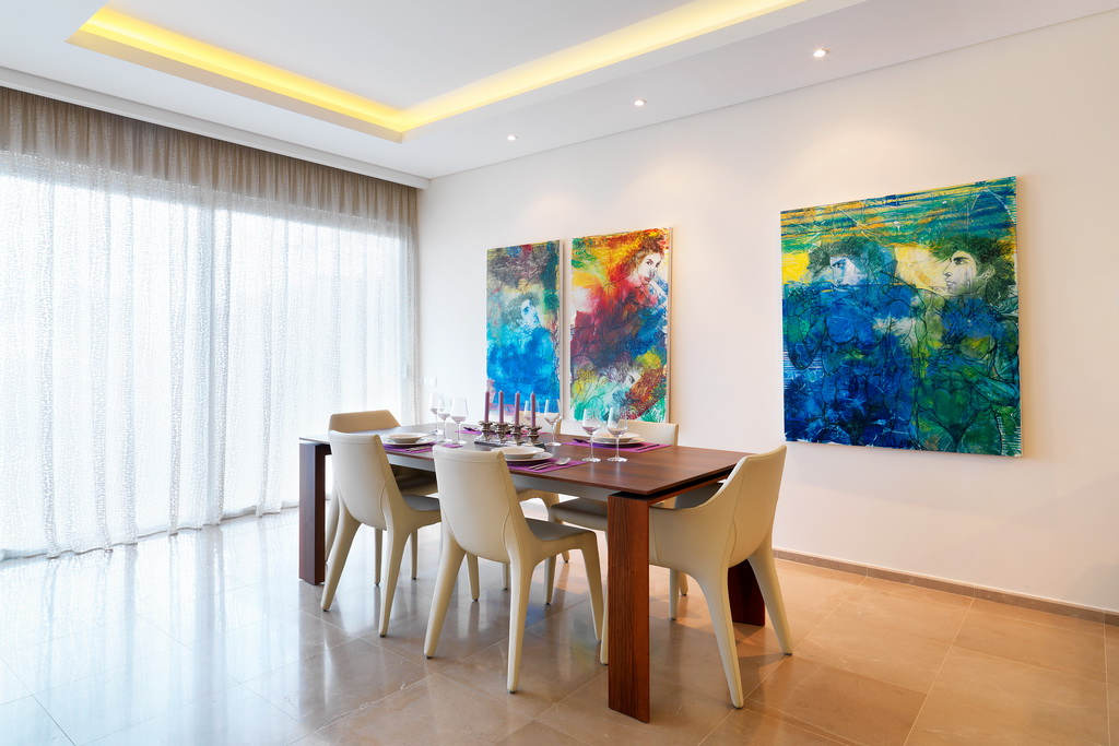 dining room with paintings in opera by askanis